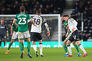 Sheffield Wednesday forward Steven Fletcher (9) & Derby County midfielder George Evans (17) in a tussle for the ball  during the EFL Sky Bet Championship match between Derby County and Sheffield Wednesday at the Pride Park, Derby, England on 11 December 2019.