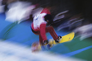 Blurred action of snowboarder.