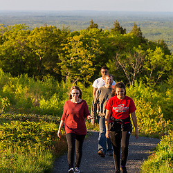 A family walking near the summit of Mount Agamenticus in York, Maine.