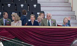 The Earl of Wessex (left), The Countess of Wessex (centre) and Savannah Phillips (right) waving at Lady Louise Windsor at the Champagne Laurent-Perrier Meet of the British Driving Society at the Royal Windsor Horse Show, which is held in the grounds of Windsor Castle in Berkshire.