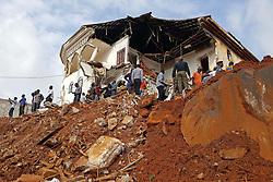 August 15, 2017 - People gather at the mudslide site in Freetown, Sierra Leone. Sierra Leone's President Ernest Bai Koroma has declared seven days of mourning across the country with immediate effect. The president made the announcement through national TV, the Sierra Leone Broadcasting Corporation on Tuesday after a devastating mudslide early Monday killed nearly 300 people on the outskirts of Freetown. (Credit Image: © Liu Yu/Xinhua via ZUMA Wire)
