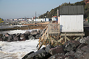 Coastal defences, Felixstowe, Suffolk, England. Emergency rock armour defences following erosion caused by winter storms endangering beach huts,
