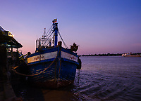 YANGON, MYANMAR - CIRCA DECEMBER 2017: Boat in the Yangon fish market at dawn.