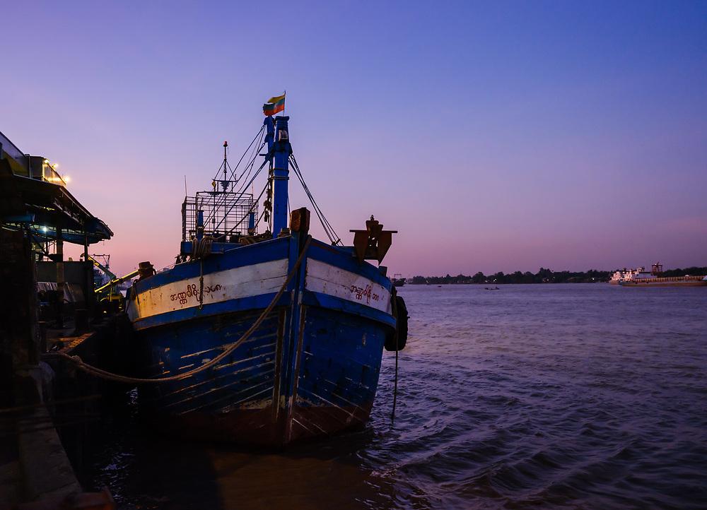 YANGON, MYANMAR - CIRCA DECEMBER 2017: Boat in the Yangon fish market at dawn.
