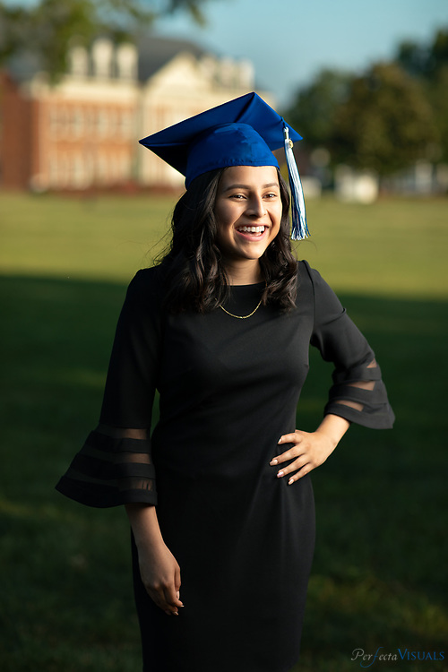 Karen Cruz Ruiz - Middle College at Bennet<br /> <br /> Karen Cruz Ruiz graduated from the Middle College at Bennett on May 23, and she'll attend Elon University as an Odyssey Scholar, a program that covers college tuition and room and board as well as offer an annual stipend and a chance to study abroad. The Odyssey program targets talented students with high financial need. Out of the hundreds of high school seniors nationwide who applied to the program, Ruiz is one of 33 students accepted.<br /> <br /> Photographed, Tuesday, May 28, 2019, in Greensboro, N.C. JERRY WOLFORD and SCOTT MUTHERSBAUGH / Perfecta Visuals