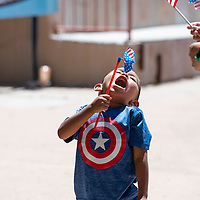 Jayceon Cleveland, 4, enjoys the free pinwheels handed out at the Fourth of July celebration on Thursday at the McKinley County Courthouse Square in downtown Gallup.