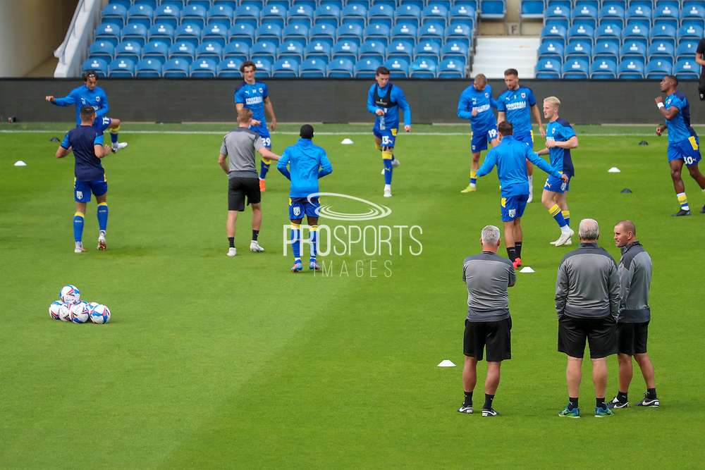 AFC Wimbledon manager Glyn Hodges, AFC Wimbledon assistant manager Nick Daws and AFC Wimbledon coach Mark Robinson watching warm up during the EFL Trophy Group O match between AFC Wimbledon and Charlton Athletic at the Kiyan Prince Foundation Stadium, London, England on 1 September 2020.