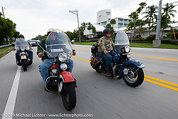 Jerry Wieland (center), Mike Butts (R) and Steve Butts (L) riding together in the Cross Country Chase motorcycle endurance run from Sault Sainte Marie, MI to Key West, FL. (for vintage bikes from 1930-1948). Stage-10 covered just 110 miles from Miami to the finish in Key West, FL USA. Sunday, September 15, 2019. Photography ©2019 Michael Lichter.