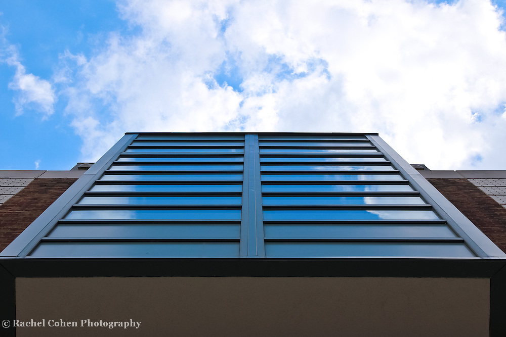 """""""Visions of Up""""<br /> <br /> Reflections and sky looking up at the library building at EMU!!<br /> <br /> Architecture: structures and buildings by Rachel Cohen"""