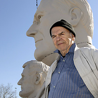Artist David Adickes poses in front of one of the six presidents at the newly constructed Presidential Park and Gardens in Pearland off Highway 288.