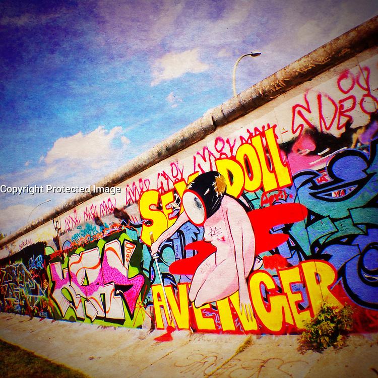 Graffiti on Berlin Wall at East Side Gallery in Berlin Germany