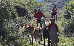 October 4, 2018 - Himachal Pradesh, India - Ganjendra Singh of India and Magar Laxmi of Nepal crosses village as they competes at the 14th edition of the Hero MTB Himalaya mountain bike race in the northern Indian state of Himachal Pradesh on 4th  October, 2018. The 14th edition of the annual cross country race is taking place over eight stages in the foothills of the Himalaya, started in Shimla on September 28, 2018 and finishing in Dharamshala on October 6,2018. (Credit Image: © Indraneel Chowdhury/NurPhoto/ZUMA Press)
