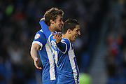 Brighton striker (on loan from Manchester United), James Wilson (21) and Brighton striker, Anthony Knockaert (27) celebrates Brighton striker (on loan from Manchester United), James Wilson (21) goal to make it 2-1 to Brighton during the Sky Bet Championship match between Brighton and Hove Albion and Huddersfield Town at the American Express Community Stadium, Brighton and Hove, England on 23 January 2016.