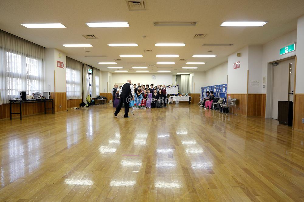 seniors meeting of recreational dance group making a memorial portrait Japan