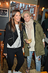 Left to right, AMANDA SHEPPARD and EMMA O'BYRNE at a quiz night hosted by Zoe Jordan to celebrate the launch of her men's ZJKNITLAB collection held at The Larrick Pub, 32 Crawford Place, London on 20th April 2016.