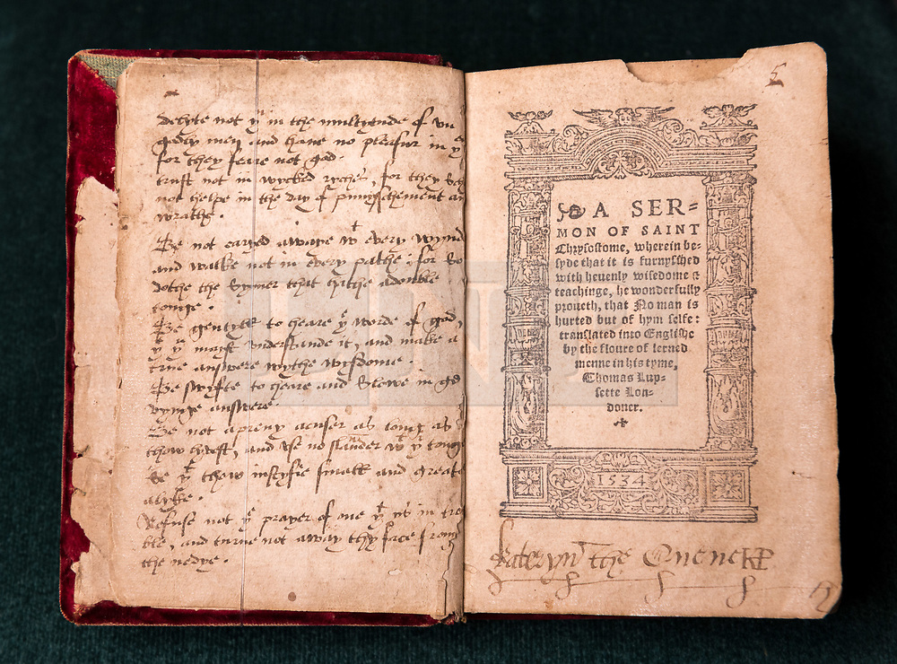 © Licensed to London News Pictures. 16/04/2018. Winchcombe, Gloucestershire, UK. Sudeley Castle's 'Royal Sudeley 1,000, Trials, Triumphs and Treasures'; a book with the formal signature (bottom right) of Katherine Parr, wife of Henry VIII. Treasures from Sudeley Castle's 1,000 year history have gone on show in a new exhibition. Called 'Royal Sudeley 1,000, Trials, Triumphs and Treasures', the newly refurbished exhibition includes a collection of priceless objects and curiosities. The exhibition includes a one-of-a-kind, life-size glass-engraved portrait of Katherine Parr by critically acclaimed artist, John Hutton. The artwork was re-discovered during the refurbishment of a holiday cottage on the estate, where it had been for decades. Its importance has now been realised and so it has been brought into the exhibition collection. Numerous items of historic significance are also on display, such as a lock of Katherine Parr's hair, her prayer book and an intricate lace christening canopy believed to have been worked on by Anne Boleyn for the christening of her daughter, Elizabeth I. Sudeley was a royal residence, closely associated with some of the most famous English monarchs, including Edward IV, Richard III, Henry VIII, Lady Jane Grey, Katherine Parr, Elizabeth I and Charles I. The Castle was even home to a secret Queen of England, Eleanor Boteler, whose royal status was unknown for centuries. Photo credit: Simon Chapman/LNP