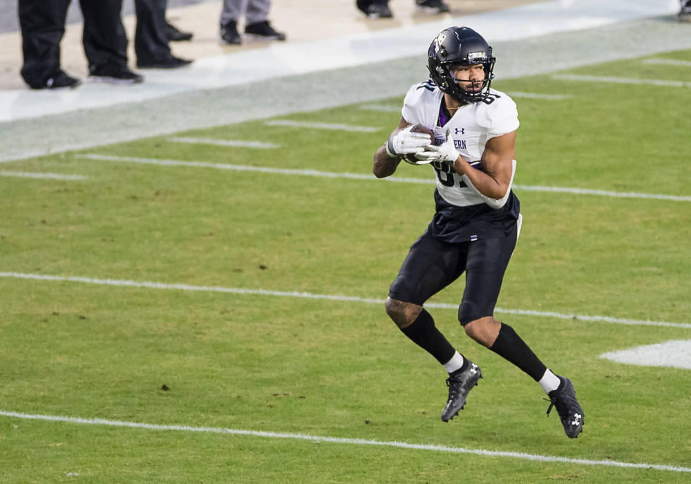 November 14, 2020:  Northwestern wide receiver Ramaud Chiaokhiao-Bowman (81) runs with the ball after the catch during NCAA football game action between the Northwestern Wildcats and the Purdue Boilermakers at Ross-Ade Stadium in West Lafayette, Indiana. Northwestern defeated Purdue 27-20.  John Mersits/CSM.