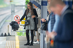© Licensed to London News Pictures 09/08/2021. <br /> Petts Wood, UK. Monday morning wet weather for a London commuter at Petts Wood Train Station in South East London. Photo credit:Grant Falvey/LNP