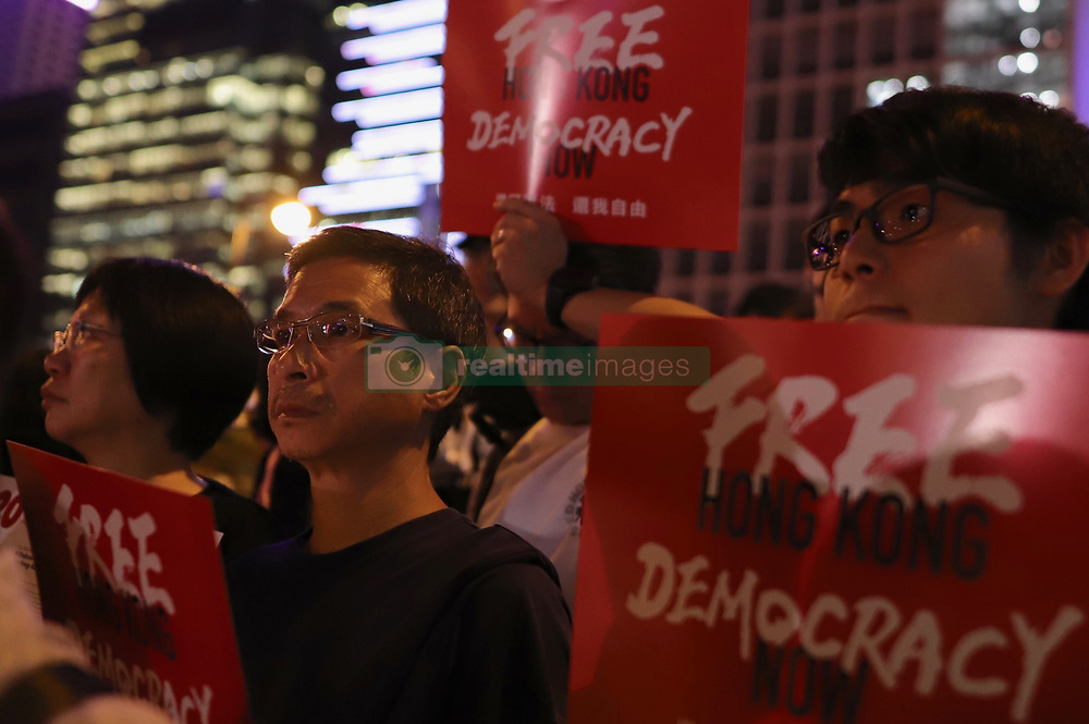 June 26, 2019 - Hong Kong, CHINA - Hong Kong citizens calling for G20 Nations to exert political pressure on China as people of Hong Kong are struggling to uphold universal value based on freedom and democracy,which is also 'promised' under the BASIC LAW and political concept of ONE CHINA TWO SYSTEMS. ( File ) June-28,2019 Hong Kong.ZUMA/Liau Chung-ren (Credit Image: © Liau Chung-ren/ZUMA Wire)