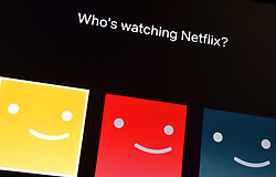 Stock photo of the Netflix customer icons, which are seen prior to selecting the named person viewing the channel, available on a smart television.