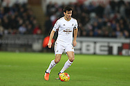 Jack Cork of Swansea city in action. Barclays Premier league match, Swansea city v West Bromwich Albion at the Liberty Stadium in Swansea, South Wales  on Boxing Day Saturday 26th December 2015.<br /> pic by  Andrew Orchard, Andrew Orchard sports photography.
