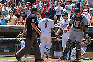 Ryan Doumit #9 of the Minnesota Twins is congratulated after hitting a home run against the Seattle Mariners on June 2, 2013 at Target Field in Minneapolis, Minnesota.  The Twins defeated the Mariners 10 to 0.  Photo: Ben Krause