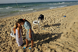 Children of settlers play on the beach near Elei Sinai, a northern Jewish settlement in Gaza, Palestinian Territories, Nov. 6, 2004. Israel's parliament recently supported compensation payments for Jewish settlers leaving the Gaza Strip, in a vital vote for Prime Minister Ariel Sharon's plan to evacuate the occupied territory.