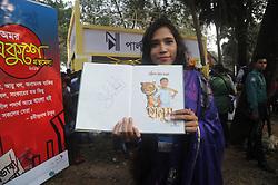 February 5, 2018 - Dhaka, Bangladesh - A girl showing Cricketer Shakib Al Hasan written a book name is ''Halum'' after buy in Ekushey Book Fair in Dhaka, Bangladesh. On February 5, 2018. (Credit Image: © Str/NurPhoto via ZUMA Press)