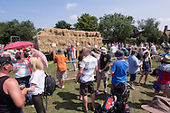 Photo by Andrew Tobin/Tobinators Ltd - 07710 761829 - A general view of the Witcham village fair during the World Peashooting Championships held at Witcham, Cambridgeshire, UK on 13th July 2013. Run in conjunction with the village fair, the Championships have been held in Witcham since 1971 when they were started by a Mr Tyson, the village schoolmaster, in order to raise funds for the village hall.Competitors come from as far afield as the USA and New Zealand to attempt to win the event. The latest technology is often used, including laser sights and titanium and carbon fibre peashooters. All peashooters must conform to strict length rules, not exceeding 12 inches, and have to hit a target 12 feet away. Shooting 5 peas at a plasticine target attached to a hay bale, the highest scorers move through the initial rounds to a knockout competition, followed by a sudden death 10-pea shootout.