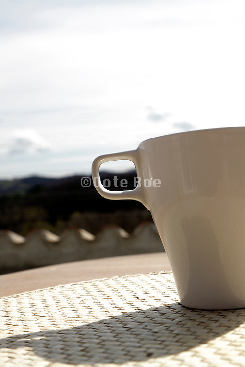 tea or coffee cup with some sky during a sunny day