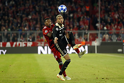 (l-r) David Alaba of FC Bayern Munchen, Hakim Ziyech of Ajax during the UEFA Champions League group E match between Bayern Munich and Ajax Amsterdam at the Allianz Arena on October 02, 2018 in Munich, Germany