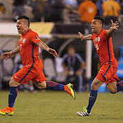 EAST RUTHERFORD, NEW JERSEY - JUNE 26:  Gary Medel #17 of Chile and Gonzalo Jara #18  of Chile celebrate victory after the penalty shoot out during the Argentina Vs Chile Final match of the Copa America Centenario USA 2016 Tournament at MetLife Stadium on June 26, 2016 in East Rutherford, New Jersey. (Photo by Tim Clayton/Corbis via Getty Images)