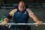 """2016/03/08 – Medellin, Colombia: Joe Gonzalez Bettencourt, 38, lifts weight during a gym session at Atanasio Girardot Stadium, Medellin, 8th March, 2016. <br /> -<br /> Joe was a teenager when a paramilitary group approached him and his friends to become part of the Bloque Cacique Nutibara gang by starting to steal and kill. Joe and his friends refused because they didn't like violence and were more interested in party and living a life like any other normal teenager. But that refuse came with a high price. Joe and his best friend were chased on motorbike and the gang shot them. Joe was hit twice, one bullet hit his neck and another bullet hit his abdomen leaving through the lower back, making him paraplegic. His friend died. <br /> At the time of the incident, Joe was trying to become a football player, so sports were always part of his life. When he understood that he would be on a wheel chair he took on sports to keep going with his life. He started to play basketball, then tennis and in both he was National Champion. It was through his wife, who also is a Paralympics athlete, that he became interested in weigh throwing and javelin. On Joe's second tournament he became national champion, a title that he still holds today. During his progression on the sport he reached 4th in the world. Joe qualified to the Rio 2016 Paralympic games, but due to quota places he might not be able to go, something that he feels is quite unfair after so much work. <br /> Asked about his feeling for the responsible people that shot him, he says, """"We must be peaceful, forgive, but never forget. I will never forget because everyday I have to sit on this chair"""". (Eduardo Leal)"""
