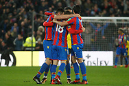 Crystal Palace players huddle together and celebrate their last gasp 2-1 win over Watford. Premier League match, Crystal Palace v Watford at Selhurst Park in London on Tuesday 12th December 2017. pic by Steffan Bowen, Andrew Orchard sports photography.