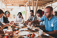 Visitors to the Syrian monastery of Deir Mar Musa eat breakfast together. Deir Mar Musa was established in the 6th century and dedicated to Saint Moses the Abyssinian.