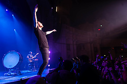 "© Licensed to London News Pictures. 25/11/2013. London, UK.   Imagine Dragons performing live at Brixton Academy. In this pic Dan Reynolds.  Imagine Dragons is an American alternative rock band from Las Vegas consisting of members Dan Reynolds (vocals, Bass drum, Guitar), Ben McKee (Bass, Backing Vocals, Keyboards), Wayne ""Wing"" Sermon (Guitar, Cello, Backing Vocals), Dan Platzman— Drums, Viola, Backing Vocals.  Photo credit : Richard Isaac/LNP"