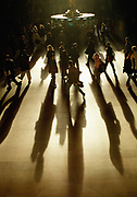 Shadows of commuters at rush hour in Grand Central Station, New York City