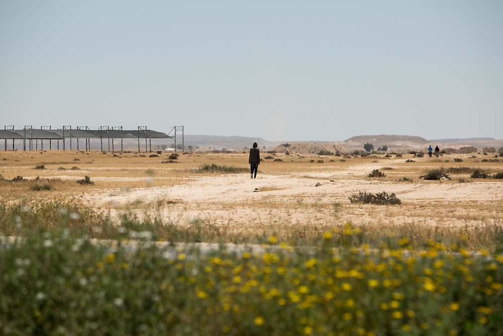 African asylum seekers are seen outside Holot detention center, where African migrants are being held in the Negev Desert, southern Israel, on May 4, 2015.