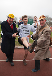 """© Licensed to London News Pictures. 03/03/2012. London, England. L-R Terry Jones, Ben Lansley, winner of the 400m race and Michael Palin. Terry Jones and Michael Palin of Monty Pythons fame today, Saturday 3 March, staged a public """"Hopathon"""" to mark the DVD release of Ripping Yarns The Complete Series, and as an homage to the episode entitled Tomkinson's School Days at the Athletics Track in  Hampstead Heath, London. Photo credit: Bettina Strenske/LNP"""