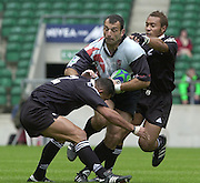 24/05/2002 (Friday).Sport -Rugby Union - London Sevens.New Zealand vs Georgia.Geogia's Besik Khamasuridze, tackled by Eric Rush (low and Antony Tuitavake.[Mandatory Credit, Peter Spurier/ Intersport Images].