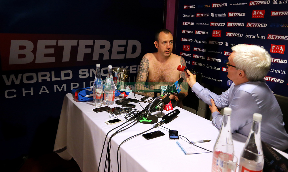 Mark Williams conducts his post match interview without any clothes after winning the 2018 Betfred World Championship at The Crucible, Sheffield.