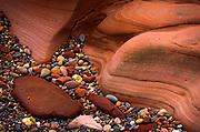 Wavy rock and pebbles on British coastline