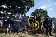CHARLOTTESVILLE, USA - August 12: White Supremacists holds a line with shields and sticks during clashes with counter protestors at Emancipation Park where the White Nationalists are protesting the removal of the Robert E. Lee monument in Charlottesville, Va., USA on August 12, 2017.