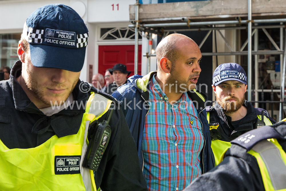 London, UK. 10th June, 2018. Police officers detain a man from a far-right group who has been protesting against the pro-Palestinian Al Quds Day march through central London organised by the Islamic Human Rights Commission. An international event, it began in Iran in 1979. Quds is the Arabic name for Jerusalem.