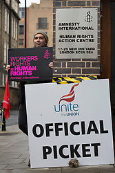 © licensed to London News Pictures. London, UK 20/11/2012. Amnesty workers staging 24-hour strike over jobs outside The Amnesty UK headquarters in London on 20/11/12. Photo credit: Tolga Akmen/LNP