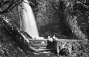 1307C-77. Wahkeena Falls Footbridge was built in 1914. It is a semi-circular barrel arch that is 46 feet long and 8 feet wide.