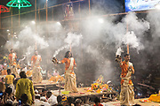 Men perform the nightly Hindu Puja Rituals in Varanasi, Uttar Pradesh, India