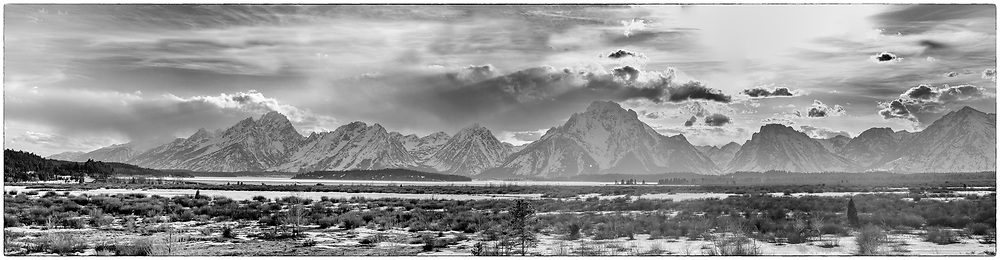 Black and White panoramic Tetons Range after a breaking winter storm