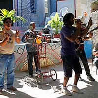 Central America, Cuba, Havana. Mario MC and Cuban musicians perform at  Muraleando Cultural and Social Community Project Center.