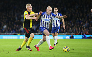 Brighton's Aaron Mooy is challenged by Watford's Will Hughes during the Premier League match at the American Express Community Stadium, Brighton and Hove. Picture date: 8th February 2020. Picture credit should read: Paul Terry/Sportimage